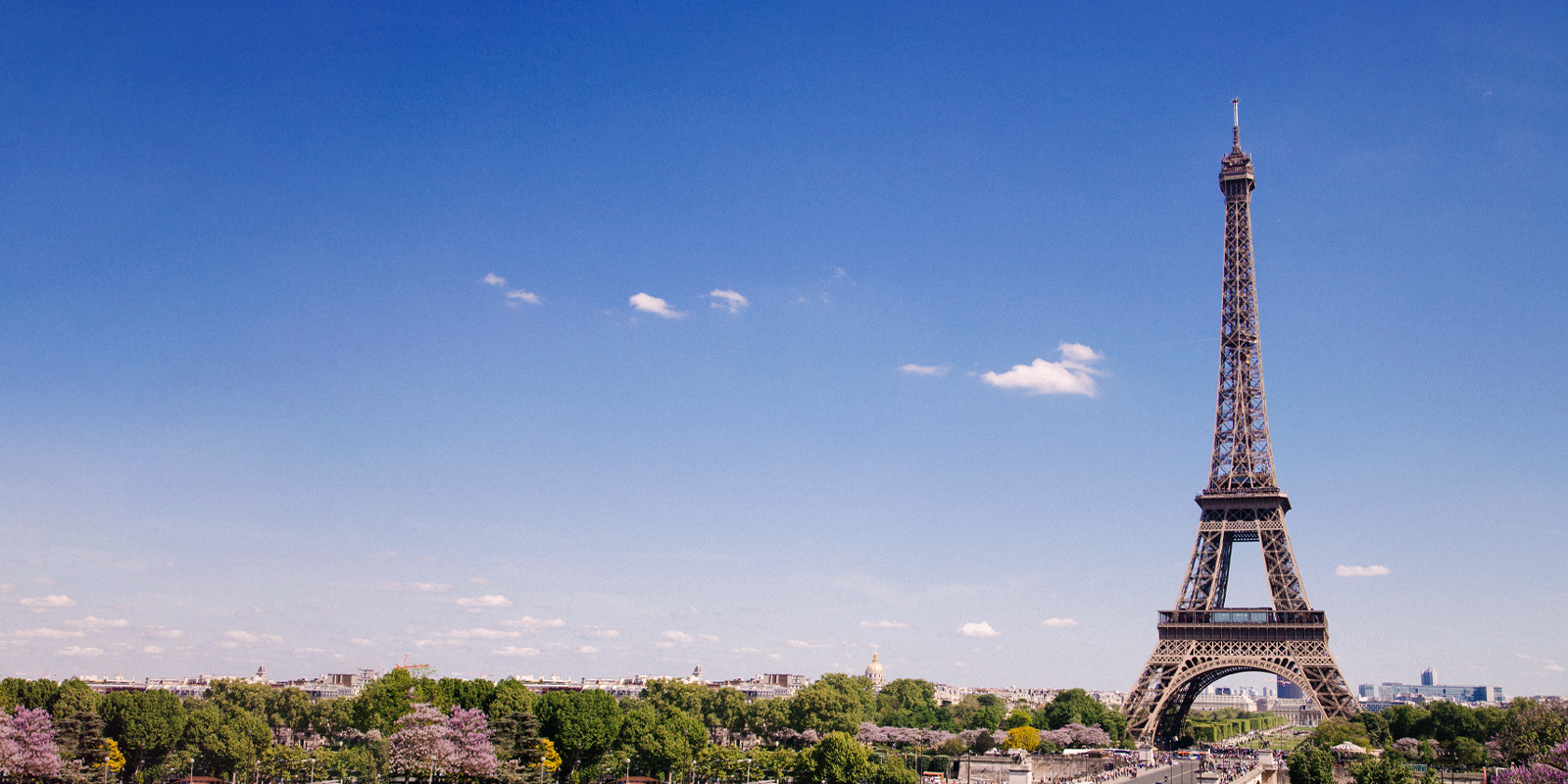 An image of blue skies with Eiffel tower