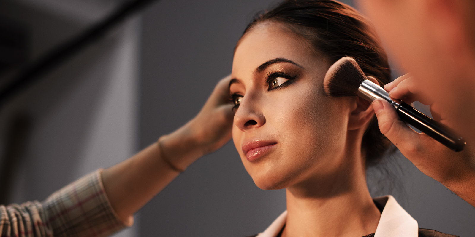 An image of a person getting making applied on her