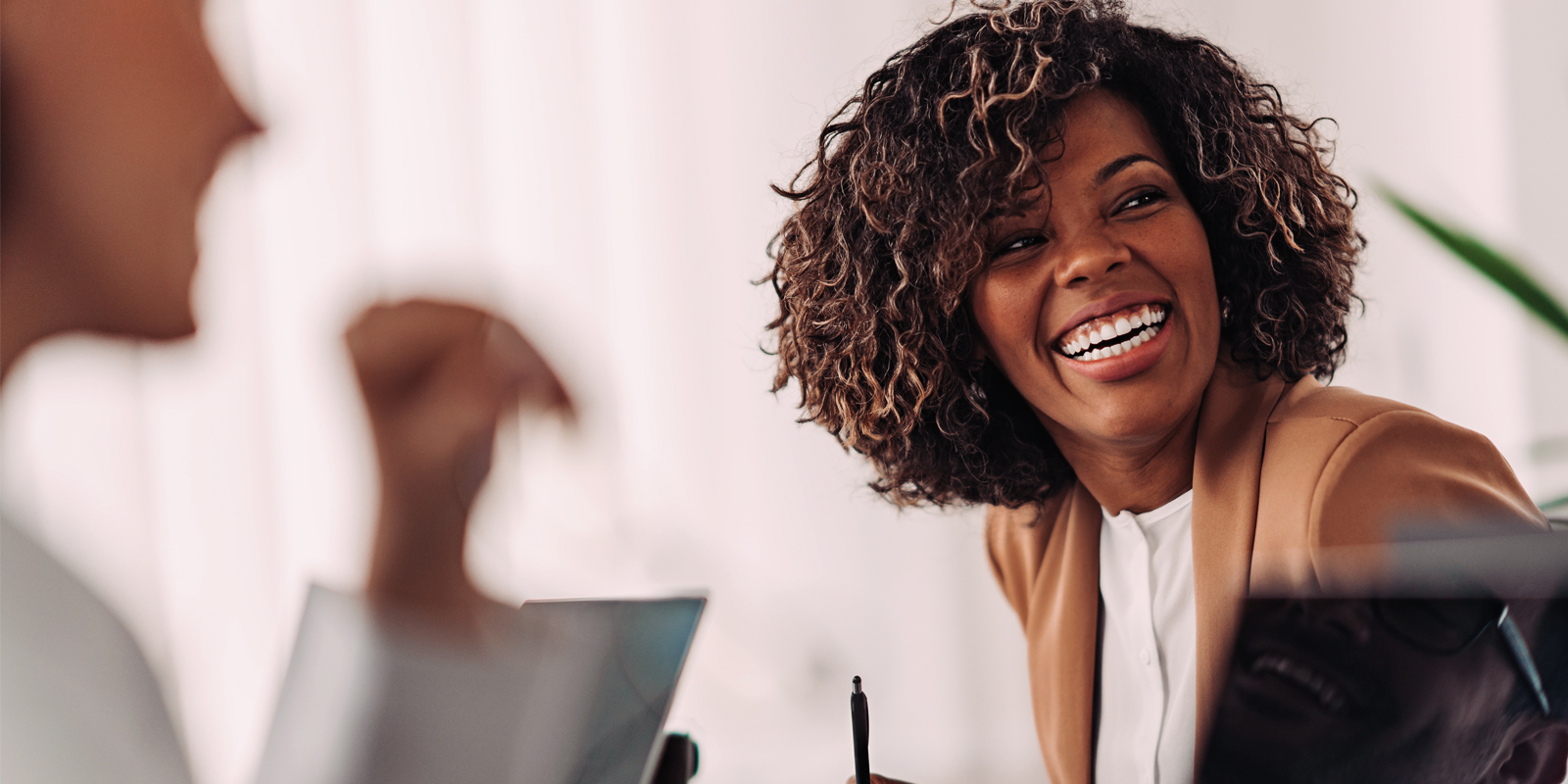 A business woman laughing with her colleagues