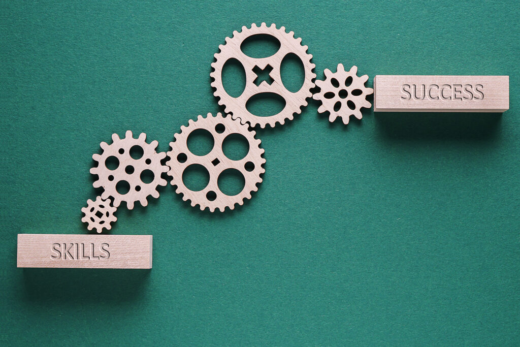 The words skills and success with images of cogs connecting them.